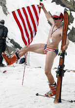 Rick Egan   |  The Salt Lake Tribune  Scott Brady, Salt Lake City, poses with the American Flag at the top of the tram,  before taking to the slopes at Snowbird, Monday, July, 4, 2011