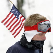 Rick Egan   |  The Salt Lake Tribune   D.J. Koppenall, Bountiful, wears the flag as he skis at Snowbird, Monday, July, 4, 2011