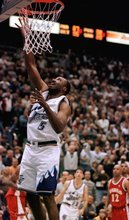 Douglas C. Pizac  |  AP file photo Utah Jazz forward Armen Gilliam scores the winning basket in the fourth quarter against the Atlanta Hawks in 2000. The former Jazz power forward known as