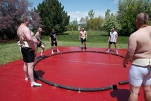 Members of NU Sumo practice with sumos in Idaho Falls. Josh Petersen is the first person on the left. Courtesy of Josh Petersen