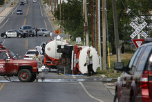 Scott Sommerdorf  |  The Salt Lake Tribune A train collided with a semi-truck traveling on Center Street in North Salt Lake, Monday, July 11, 2011. The impact tipped over the rear tanker of the truck, which was empty.