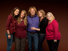 In this publicity image released by TLC, Kody brown, center, poses with his wives, from left,  Robyn, Christine, Meri and Janelle in a promotional photo for the reality series,
