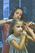 Paul Fraughton  |  The Salt Lake Tribune. Mindy McKnight works on a hairstyle on her daughter.