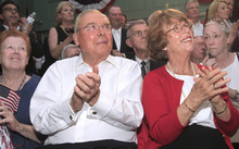 Associated Press file photo Jon Huntsman Sr., and his wife, Karen, listen as their son, former Utah Gov. Jon Huntsman, speaks at the town hall in Exeter, N.H., on June 21. Earlier that day, the younger Huntsman announced his candidacy for president at Liberty State Park in New Jersey.