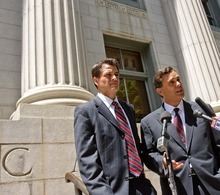 Trent Nelson  |  The Salt Lake Tribune Attorney Jonathan Turley, right, answers questions on the steps of the U.S. District Court in Salt Lake City on July 13 about his filing challenging Utah's law against polygamy on behalf of the Kody Brown family. At left is attorney Adam Alba