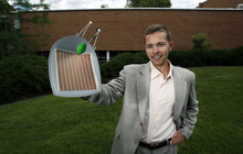 Francisco Kjolseth  |  The Salt Lake Tribune Tom Melburn, one of several U. students who won sustainability grants from a student fund that pays for on-campus conservation projects, holds up a solar panel leaf. His proposal of covering the south wall of Orson Spencer Hall with solar panels that replicates the look of ivy is scheduled to be installed in the fall.