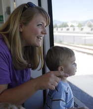 Rick Egan   |  The Salt Lake Tribune Amy Bennion rides the new Mid-Jordan TRAX line with her 2-year-old son Zachary as part of a public demonstration offered to