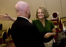 Scott Sommerdorf  |  The Salt Lake Tribune Retiring representative for District 30 Jackie Biskupski reaches to congratulate her replacement, Brian Doughty.