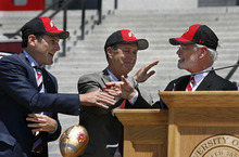 Scott Sommerdorf  |  The Salt Lake Tribune Pac-12 commissioner Larry Scott (left), Utah athletic director Chris Hill, and Utah interim president Lorris Betz (right) congratulate each other after the ceremony to welcome the university into the Pac-12. The University of Utah officially became a member of the Pac-12 conference on Friday, July 1, 2011. The school ushered it in with a big celebration on the south steps of the State Capitol.