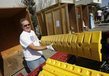 Francisco Kjolseth  |  The Salt Lake Tribune Gary Gilgen, of Taylorsville, loads up the items found in the storage unit of his winning bid during a recent auctions at A-1 Pioneer Moving & Storage in North Salt Lake on July 2. A few dozen people showed up to bid on six storage containers with a number of items containing such random items as film reels, furniture, tools and wire covers.