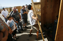 Francisco Kjolseth  |  The Salt Lake Tribune People gather around as one of six storage units is cracked open by Josh Young before people decide to bid on whatever items may be found inside during a recent auctions at A-1 Pioneer Storage in North Salt Lake on July 2. The belongings of someone who has defaulted on their storage units could contain valuable items or things bound for the dump as people are only allowed to peek in and take a gamble on the value of what they can see.