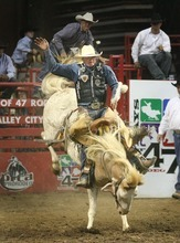 Paul Fraughton  |  The Salt Lake Tribune. Taos Muncy of Corona New Mexico rides 5+2 Sure Shot in the Saddle Bronc Riding competition on the opening night of the Days of 47 Rodeo at The Maverick Center on  Monday  July 18, 2011