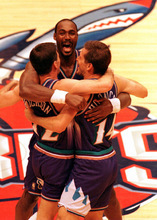 John Stockton, left, gets a hug from Utah Jazz teammates  Karl Malone, center, and Jeff Hornacek after the final shot of the game against Houston to win the Western Conference Finals Championship title in 1997. An unparalleled work ethic defined Malone's 19-year NBA career, which culminates Friday night with his induction into the Naismith Basketball Hall of Fame.
