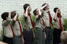 Francisco Kjolseth  |  The Salt Lake Tribune Scouts salute as they raise the flag in honor of David Rayborn, 12, during funeral services at the Granite Park Stake Center in Salt Lake City on Tuesday. Rayborn was struck and killed by lightning on July 13 during a weeklong Boy Scout camp at Scofield Reservoir.