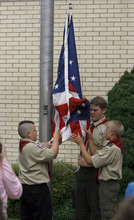 Francisco Kjolseth  |  The Salt Lake Tribune Scouts raise the flag in honor of David Rayborn, 12, at the Granite Park Stake Center in Salt Lake City on Tuesday. Rayborn was struck and killed by lightning on July 13 during a weeklong Boy Scout camp at Scofield Reservoir.