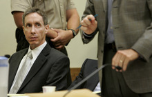 Jud Burkett  |  Associated Press file photo Warren Jeffs looks at one of his attorneys at his sentencing on accomplice to rape charges in St. George. Jeffs got five years to life in prison for his role in the arranged marriage of teenage cousins, but the verdict was later overturned by the Utah Supreme Court.