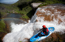 Kayaker Jeffrey Hazboun, a Utah State University doctoral candidate in physics, runs a fall on Russia's Karymskaya River  on Kamchatka last summer. Photo courtesy of Reel Water Productions