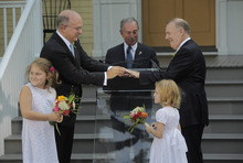 In this photo provided by the Office of the Mayor , New York Mayor Michael Bloomberg officiates the marriage ceremony of Jonathan Mintz, left, and John Feinblatt, Sunday, July 24, 2011 at Gracie Mansion in New York. Hundreds of gay couples dressed in formal suits and striped trousers, gowns and T-shirts recited vows in emotion-choked voices and triumphantly hoisted their long-awaited marriage certificates on Sunday as New York became the sixth and largest state to recognize same-sex weddings. (AP Photo/Office of the Mayor, Edward Reed)