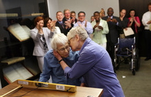 Phyllis Siegel, 76, right, kisses her wife Connie Kopelov, 84, after exchanging vows at the Manhattan City Clerk's office with New York City Council Speaker Christine C. Quinn in attendance, back left, on the first day New York State's Marriage Equality Act goes into effect, on Sunday, July 24, 2011.(AP Photo/Michael Appleton/Pool)