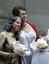 Carol Anastasio, left, and Miriam Brown, both of New York, react after getting married at the Manhattan City Clerk's office, Sunday, July 24, 2011 in New York. (AP Photo/Jason DeCrow)
