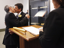 Same-sex couple Daniel Hernandez, 53, right, and Nevin Cohen, 48, kiss after being married at the City Clerk's Office in New York, Sunday, July 24, 2011. A state law signed June 24 by Democratic Gov. Andrew Cuomo went into effect at 12:01 on Sunday, allowing hundreds of couples statewide to tie the knot, including 823 in New York City alone.  (AP Photo/Shannon Stapleton, Pool)