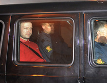Jon-Are Berg-Jacobsen  |  The Associated Press Norway's twin terror attack suspect Anders Behring Breivik, left, sits in an armored police vehicle Monday after leaving the courthouse following a hearing in Oslo, Norway, where he pleaded not guilty.