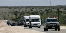Officials escort two buses Friday April 4, 2008 from the retreat built by the Fundamentalist Church of Jesus Christ of Latter Day Saints, located near El Dorado, Texas. Child welfare officials and state troopers removed at least one busload of children from the secretive West Texas religious retreat built by polygamist leader Warren Jeffs following a complaint to state authorities.  (AP Photo/Harry Cabluck)