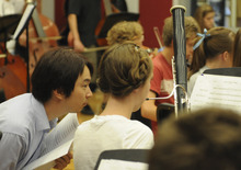 Utah Symphony associate conductor David Cho gives pointers to a young bassoonist at the Lyceum Music Festival. Courtesy Photo