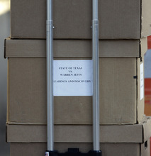 Documents related to the trial of Polygamist leader Warren Jeffs arrive at the Tom Green County Courthouse, Monday, July 25, 2011, in San Angelo, Texas, where jury selection is set to begin. Jeffs faces two counts of sexual assault of a child.  (AP Photo/Eric Gay)