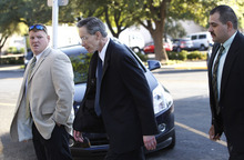 Polygamist leader Warren Jeffs, center, arrives at the Tom Green County Courthouse, Monday, July 25, 2011, in San Angelo, Texas, where jury selection is scheduled to begin. Jeffs faces two counts of sexual assault of a child.  (AP Photo/Eric Gay)