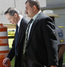 Polygamist leader Warren Jeffs, left, departs the Tom Green County Courthouse, Monday, July 25, 2011, in San Angelo, Texas, where jury selection began Monday. Jeffs faces two counts of sexual assault of a child.  (AP Photo/Eric Gay)