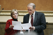 File Photo  |  The Salt Lake Tribune Rep. Julie Fisher, R-Fruit Height, compares notes on the House floor with then-Rep. Ron Bigelow, R-West Valley City. Fisher resigned Tuesday to become director of the state Department of Community and Culture. Bigelow resigned previously to take the job of budget director to Gov. Gary Herbert.