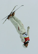 Jeret 'Speedy' Peterson of the United States jumps off the ramp during practice ahead of Men's Aerials final at the Turin 2006 Winter Olympic Games at Sauze d'Oulx, Italy, Thursday, Feb. 23, 2006. (AP Photo/Andrew Medichini)