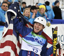 FILE- In this Feb. 25, 2010 file photo, Jeret Peterson of the United States, celebrates his Olympic silver medal in the men's freestyle aerials final at the Vancouver 2010 Olympics in Vancouver, British Columbia. Utah police say Peterson has killed himself in an isolated canyon.  The Unified Police of Greater Salt Lake said Peterson called 911 before shooting and killing himself on Monday evening, July 25, 2011. (AP Photo/Bela Szandelszky, File)