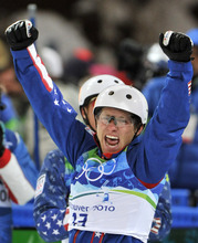 FILE - In this Feb. 25, 2010, file photo, Jeret Peterson of the USA celebrates his Olympic silver medal in the men's freestyle aerials final at the Vancouver 2010 Olympics in Vancouver, British Columbia. The Unified Police of Greater Salt Lake say Olympic silver medalist Peterson called 911 before shooting and killing himself on Monday evening, July 25, 2011. (AP Photo/Bela Szandelszky, File)