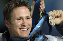 FILE - In this Feb. 26, 2010 file photo, Jeret Peterson, of the United States, holds his silver medal during the medals ceremony for the men's freestyle skiing aerials at the Vancouver 2010 Olympics in Vancouver, British Columbia. Utah police say Peterson has killed himself in an isolated canyon. The Unified Police of Greater Salt Lake said Peterson called 911 before shooting and killing himself on Monday evening, July 25, 2011. (AP Photo/Gerry Broome, File)