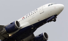 Carlos Osorio  |  The Associated Press A Delta jet takes off at Detroit Metropolitan Airport in Romulus, Mich.
