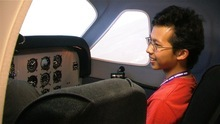 Nicolle Huang, 17 from Los Angeles, CA takes a co-pilot seat in Westminster College's Frasca 142 flight simulator. Fellow camper, Stephanie Schott, 17 from Park City is running the controls.  Photo: Emily Johnson