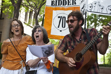 Chris Detrick | The Salt Lake Tribune  Supporters of Tim DeChristopher, Krista Bowers, Joan Gregory and Miles Biddulph sing during a rally across from the Federal Courthouse in Salt Lake City on Tuesday, July 26, 2011. DeChristopher, the 29-year-old climate activist turned environmental folk hero, was sentenced Tuesday to spend two years in prison for disrupting a federal oil and gas lease auction, and fined $10,000.