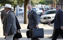 Eric Gay  |  The Associated Press Prosecutor Eric Nichols, center, arrives at the Tom Green County Courthouse on Tuesday in San Angelo, Texas.