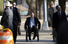 Eric Gay  |  The Associated Press Texas Attorney General Greg Abbott, center, arrives at the Tom Green County Courthouse on Tuesday in San Angelo, Texas. Jury selection began its second day in the trial of Warren Jeffs, the FLDS leader accused of sexually assaulting two underage girls.