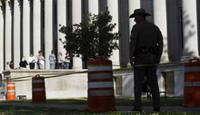 Eric Gay  |  The Associated Press A state trooper keeps watch as prospective jurors arrive at the Tom Green County Courthouse on Tuesday in San Angelo, Texas. Jury selection began its second day in the trial of Warren Jeffs, the FLDS leader accused of sexually assaulting two underage girls.