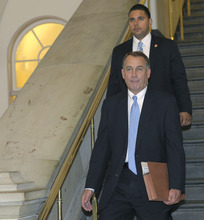 House Speaker John Boehner of Ohio walks to a meeting on Capitol Hill in Washington, Thursday, July 28, 2011, as debt talks continue. (AP Photo/Susan Walsh)