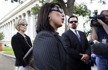 Tony Gutierrez  |  The Associated Press  Attorney's Emily Munoz Detoto, center, Deric Walpole, right, and an unidentified member of the former defense team for polygamist leader Warren Jeffs talk with reporters in front of the Tom Green County Courthouse in San Angelo, Texas, on Thursday. Jeffs will represent himself at his sexual assault trial after dismissing his latest legal team, the seventh one, Thursday, just before his trial was to begin.