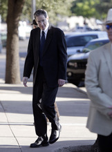Tony Gutierrez  |  The Associated Press  A law enforcement official stands by as Polygamist sect leader Warren Jeffs, left, arrives at the Tom Green County Courthouse Thursday in San Angelo, Texas. Jeffs' much-anticipated Texas trial begins in earnest Thursday, with prosecutors claiming he sexually assaulted girls he manipulated into