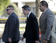 Tony Gutierrez  |  The Associated Press  Polygamist sect leader Warren Jeffs, center, arrives at the Tom Green County Courthouse escorted by law enforcement officials Thursday in San Angelo, Texas. Jeffs' much-anticipated Texas trial begins in earnest Thursday, with prosecutors claiming he sexually assaulted girls he manipulated into