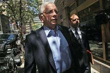 NBA commissioner David Stern, left, and NBA spokesperson Mike Bass arrives at a midtown hotel for a meeting with the players' union, Thursday, June 30, 2011 in New York. Negotiators for owners and players will meet Thursday, about 12 hours before the expiration of the collective bargaining agreement. (AP Photo/Mary Altaffer)