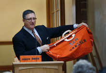 Scott Sommerdorf  |  The Salt Lake Tribune Sam Bracken shows the orange duffle bag that prompted the name of his foundation. Brackenshared his story of moving from being a homeless teen to a successful businessman with youth who've been in foster care. He has founded