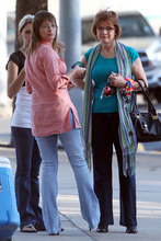 Flora Jessop, center, a former member of the Fundamentalist Church of Jesus Christ of Latter Day Saints, waits outside the Tom Green County Courthouse Monday, Aug. 1, 2011, for the start of court proceedings in the trial of Warren Jeffs.  In a motion filed Monday, Jeffs quoted God as saying state District Judge Barbara Walther should