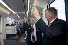 Al Hartmann  |  The Salt Lake Tribune UTA General Manager Michael Allegra, left, talks to Salt Lake County Mayor Peter Corroon as a new stepless Trax train leaves the Daybreak Parkway Station after a ceremony Tuesday at Daybreak.   The train continued up the line to the West Valley Central Station. The new lines open for customers Sunday.